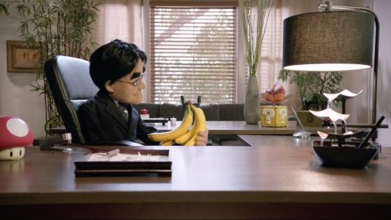 Nintendo Digital Event E3 2015 - Satoru Iwata muñeco viendo platanos