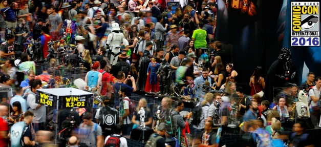 Attendees crowd the convention floor during opening day of Comic-Con International in San Diego, California